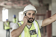 Construction worker on cell phone in construction site - ZEF007871