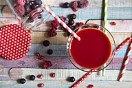 Glass of red fruit smoothie - YFF000504