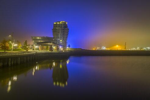 Germany, Hamburg, Marco Polo Tower and Marco Polo Terraces illuminated at night - NKF000426