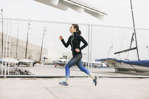 Spain, Barcelona, jogging woman - EBSF001219
