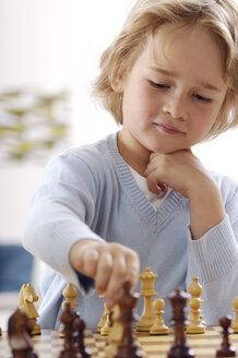 Portrait of little boy playing chess - GUFF000212