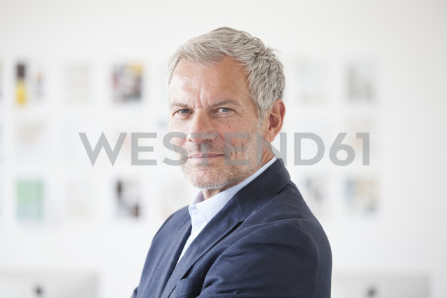Portrait of confident businessman - RBF003994