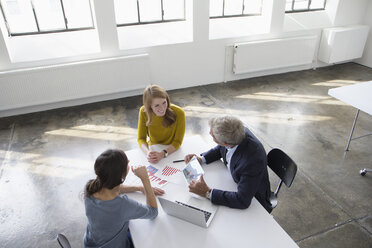 Businessman and two women in conference room having a meeting - RBF004039
