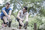 Two young men excercising together - ZEF007918