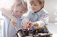 Two little boys disassembling an old radio - GUFF000223