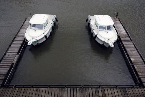 Germany, Duesseldorf, two similar  motor yachts moored at jetty of Media Harbour - GUFF000232