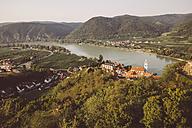 Austria, Wachau, Duernstein, Duernstein monastery with blue spire at Danube river - AIF000254