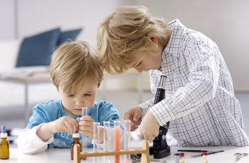 Two little boys playing with utensils of chemical laboratory - GUFF000235