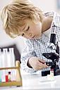 Portrait of blond little boy using microscope - GUFF000238