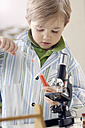 Portrait of little boy with test tubes and microscope - GUFF000244