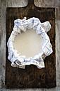 Sieving oat milk with kitchen towel - EVGF002672