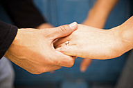 Close-up of couple holding hands - SIPF000023