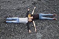 Relaxed young couple lying on stones - SIPF000029