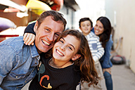 Spain, Barcelona, portrait of happy little girl hugging her father - VABF000040