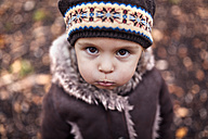 Portrait of pouting little girl in autumn - MGOF001254