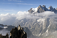 France, Ecrins Massif, Aiguille Noire de Peuterey and Mont Pelvoux, cheering mountaineer on summit - ALRF000318