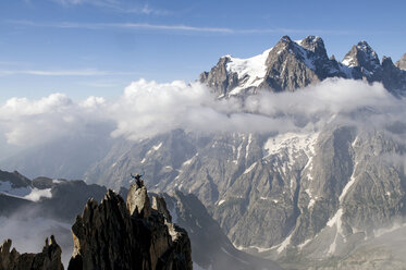 France, Ecrins Massif, Aiguille Noire de Peuterey and Mont Pelvoux, cheering mountaineer on summit - ALRF000318