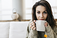Portrait of woman with cup of tea - JRFF000285