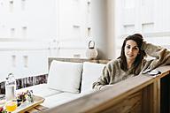 Portrait of woman relaxing on balcony - JRFF000288