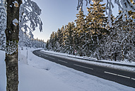 Germany, Saxony-Anhalt, Harz National Park, Country road in winter - PVCF000741