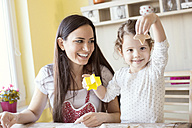 Portrait of mother and her little daughter baking together - HAPF000147