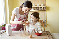 Mother and her little daughter baking together - HAPF000159