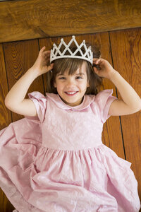 Portrait of smiling little girl dressed up as a princess - LVF004412