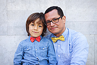 Father and son wearing bow ties, portrait - VABF000050