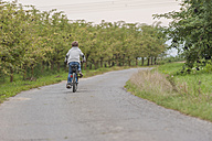 Back view of little boy riding bicycle - PAF001523