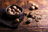 Whole and cracked walnut on wood - HAPF000165