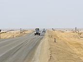 Namibia, Erongo Region, Cars driving on lonely coastal road C64 - AM004667