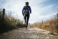Spain, Tarragona, Woman running - JRFF000348