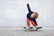 Portrait of little boy balancing on skateboard - VABF000054