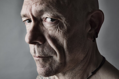 Portrait of sceptical looking man with bald - JATF000818