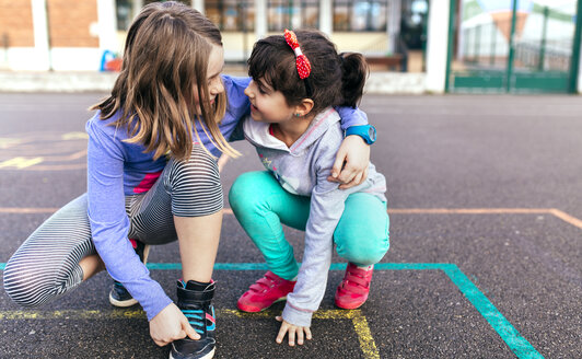 Two little girls playing together on the street - MGOF001275