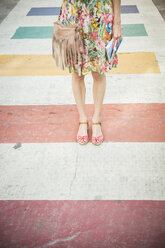 USA, Florida, Key West, woman standing on multicolored crosswalk - CHPF000207