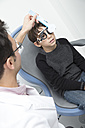 Optometrist examining eyesight of boy - ERLF000099