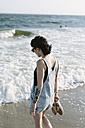 USA, New York, Coney Island, young woman on the shoreline - GIOF000646