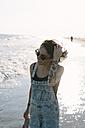 USA, New York, Coney Island, young woman on the shoreline - GIOF000649