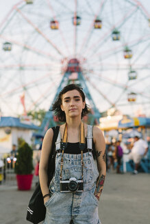 USA, New York, Coney Island, young woman at the amusement park - GIOF000673