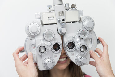 Woman at the optometrist making an eye test - ERLF000113