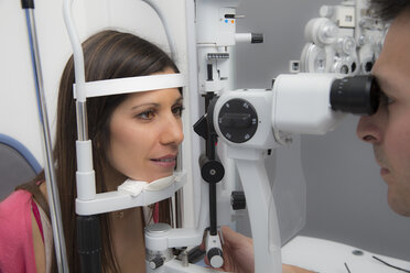 Woman at the optometrist making an eye test - ERLF000116