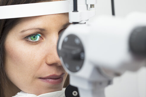 Woman at the optometrist making an eye test - ERLF000119