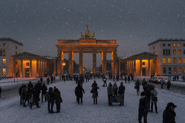 Germany, Berlin, view to Brandenburger Tor at snow fall in the evening - ZM000450