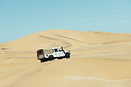 Namibia, Namib desert, Swakopmund, 4x4 car driving among the dunes in the desert - GEMF000639