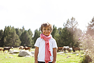 Spain, Cerdanya, portrait of smiling little boy wearing pink scarf - VABF000075