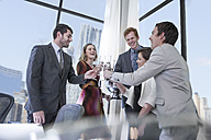 Business people celebrating success in office, clinking glasses - ZEF008017