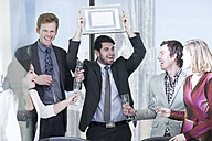 Business people celebrating success in office - ZEF008023