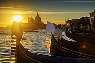 Italy, Veneto, Venice, Gondolas at sunset, Santa Maria della Salute in the background - HAMF000133