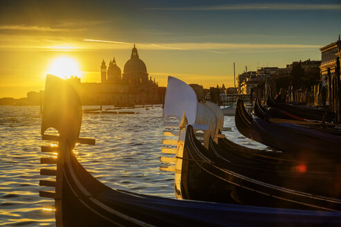 Italy, Veneto, Venice, Gondolas at sunset, Santa Maria della Salute in the background - HAMF000133